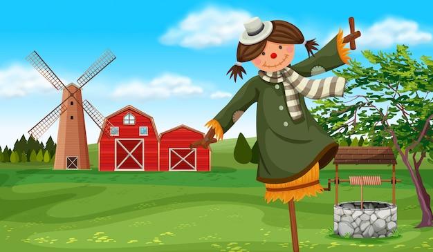 Épouvantail dans le champ de la ferme