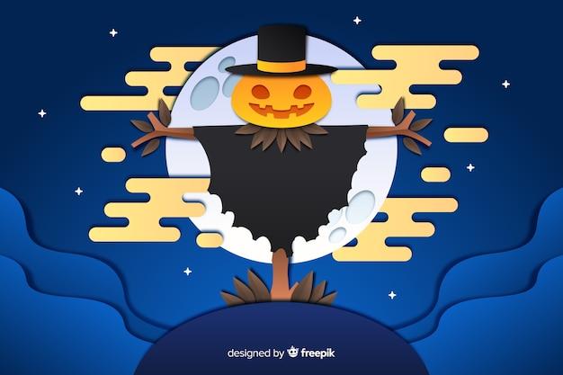 Épouvantail sur fond d'halloween en pleine lune