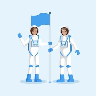 Une équipe d'astronautes plaçant le drapeau à plat
