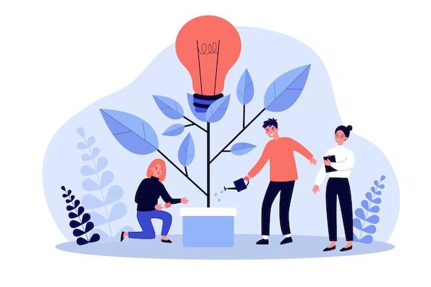 Équipe commerciale arrosant l'usine d'innovation