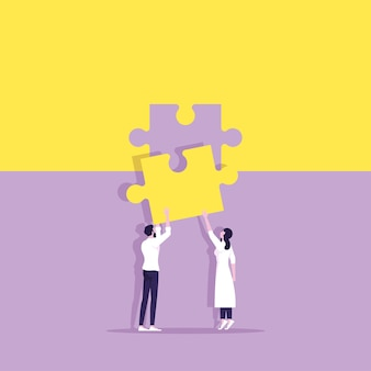 Équipe commerciale debout avec la tenue du puzzle dans les mains mettant en puzzle