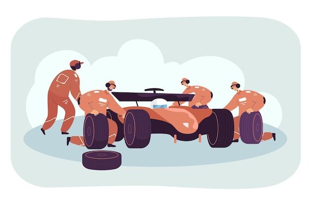 Équipe de mécaniciens réparant une voiture de course au stand
