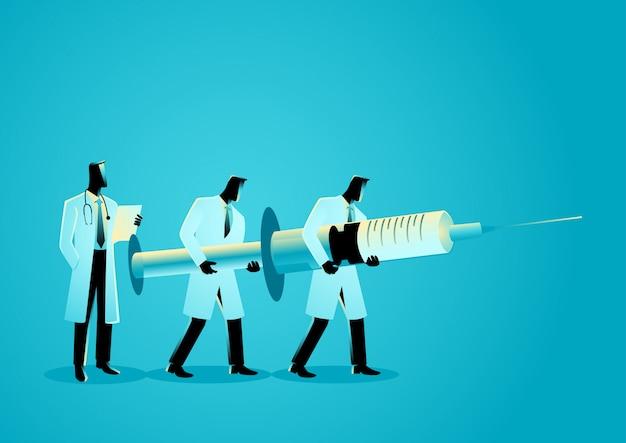 Équipe de médecins portant une aiguille géante