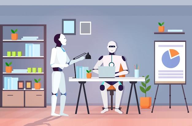 Équipe de robots modernes à l'aide de collègues de travail robotiques