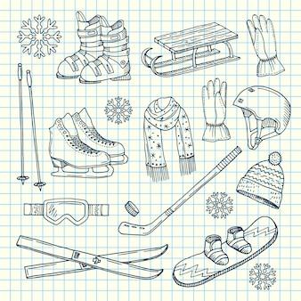 Équipement de sports d'hiver dessiné à la main et attributs sur feuille de cahier