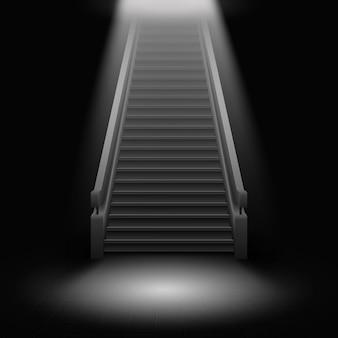 Un escalier avec des marches menant à la lumière sur fond noir