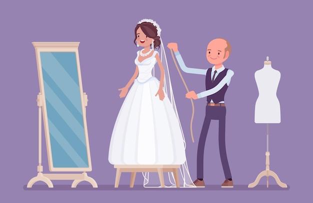 Essayage de robe de mariée, retouches avec un tailleur