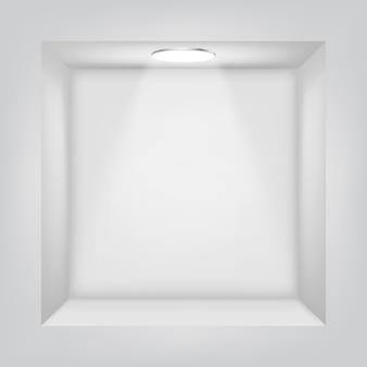 Étagère blanche dans le mur avec une source lumineuse.