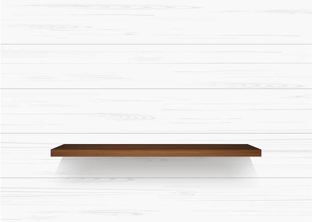 Étagère en bois sur un mur blanc
