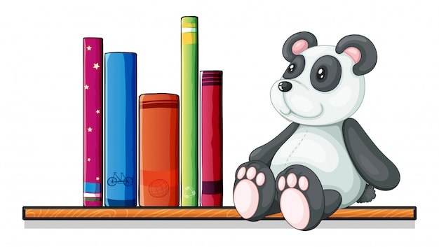 Une étagère avec des livres et un panda jouet
