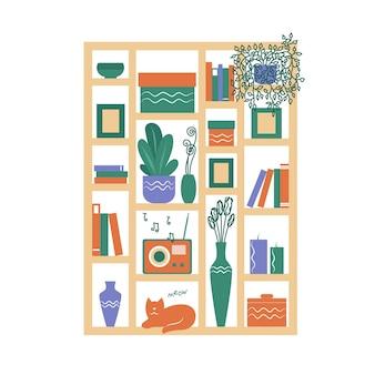 Une étagère avec des livres des vases des fleurs une radio un chat intérieur du salon