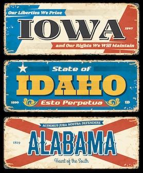 Les états-unis indiquent des plaques de métal rouillées. iowa, idaho et alabama panneaux routiers usés et minables, panneau grungy.