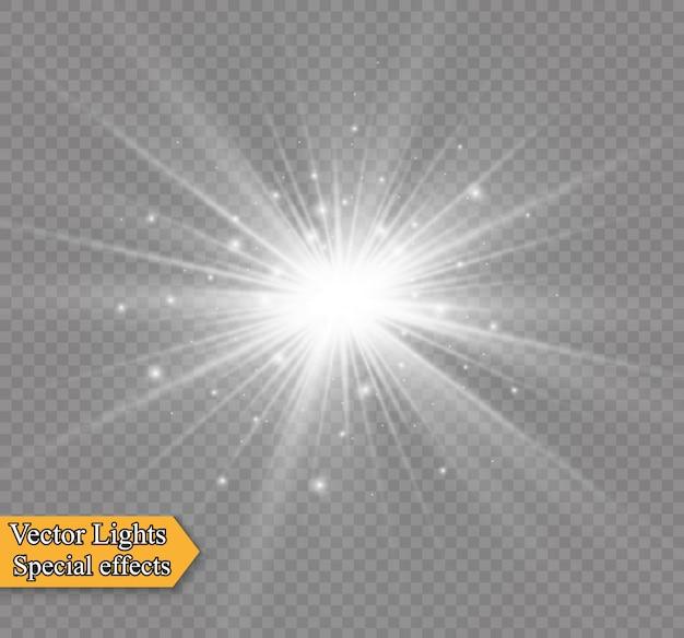 Des étincelles blanches scintillent d'un effet de lumière spécial. scintille sur fond transparent. modèle abstrait de noël. particules de poussière magique étincelante