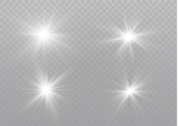 Des étincelles blanches scintillent d'un effet de lumière spécial. scintille sur fond transparent. modèle abstrait de noël. particules de poussière magique étincelante.