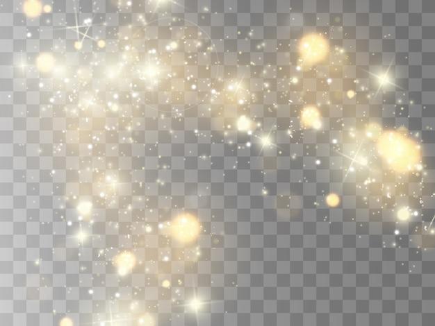 Des étincelles et des étoiles dorées scintillent effet de lumière spécial. scintille sur fond transparent.