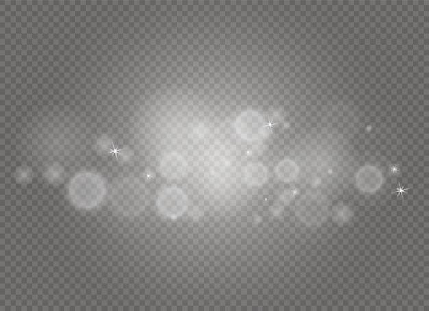 Des étincelles et des étoiles scintillent, isolées. des particules de poussière magiques scintillantes.