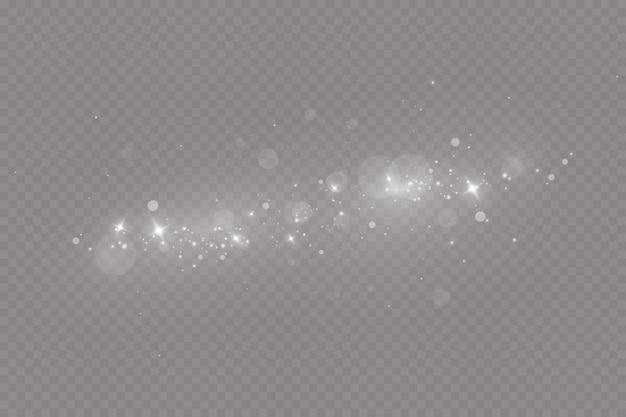 Les étincelles de poussière et les étoiles brillent d'une lumière spéciale effet de lumière de noël particules scintillantes