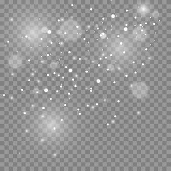 Les étincelles de poussière et les étoiles dorées brillent d'une lumière spéciale. scintille sur un fond transparent. effet de lumière de noël. des particules de poussière magiques scintillantes.