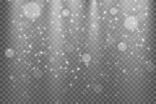 Les étincelles de poussière et les étoiles dorées brillent d'une lumière spéciale. scintille sur un fond transparent