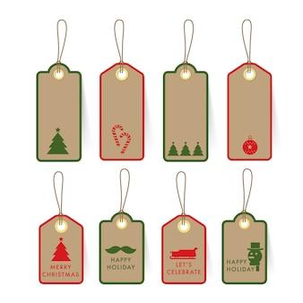 Étiquette et étiquette de carte-cadeau de noël sur la conception de papier avec des éléments de noël