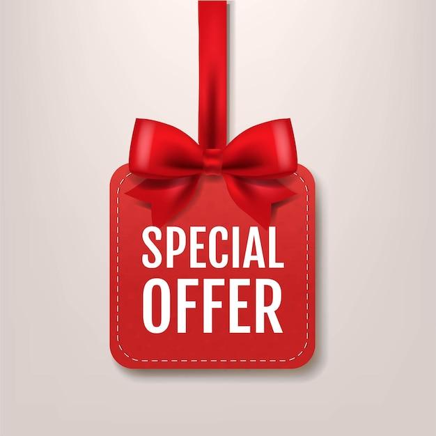 Étiquette d'offre spéciale de papier rouge avec ruban de soie rouge