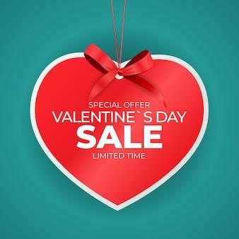 Étiquette de vente coeur saint valentin avec noeud