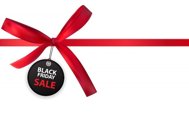 Étiquette de vente vendredi noir avec arc et ruban isolé on white