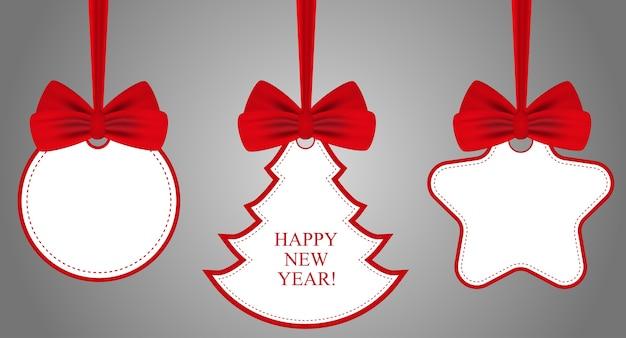 Étiquettes avec des arcs rouges. symboles de vacances de noël ou du nouvel an.