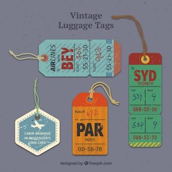 Étiquettes à bagages grunge en style vintage