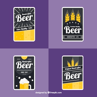 Étiquettes de bière sombre avec détails en jaune