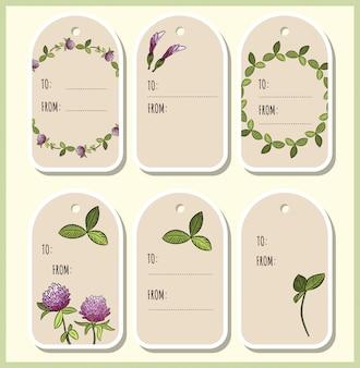 Etiquettes cadeaux fleurs et feuilles de trèfle rouge