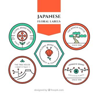Étiquettes floraux japonais dans le style linéaire