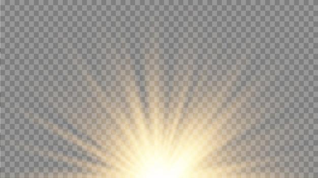 Étoile brillante. des particules de poussière magiques étincelantes. ensemble de lumière rougeoyante jaune et or explose sur un fond transparent. soleil brillant transparent, flash brillant. effet lumineux. scintille.