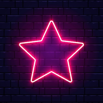 Étoile néon. étoile rose vif sur le mur de briques