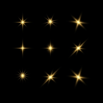 Étoiles dorées brillantes effets de lumière éblouissement explosion de paillettes lumière dorée