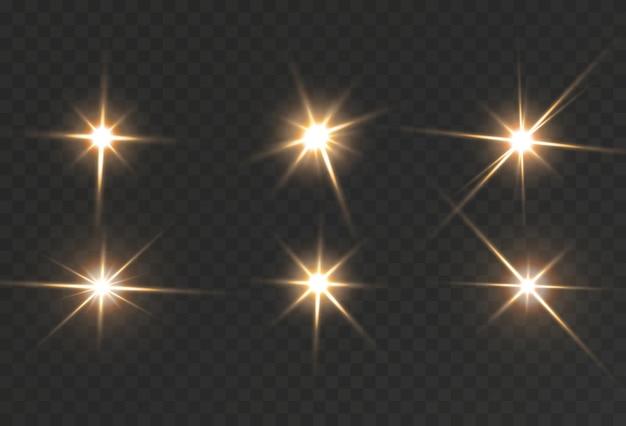 Étoiles dorées brillantes isolées sur fond noir
