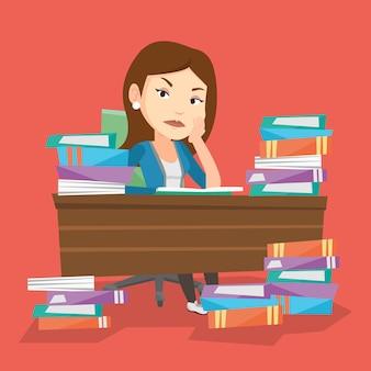 Étudiant assis à table avec des piles de livres.