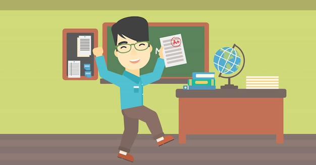 Étudiant tenant le papier de test avec le meilleur résultat.