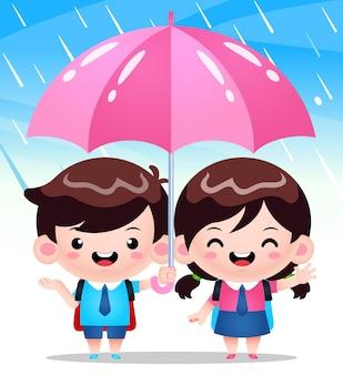Étudiants mignons sous parapluie pendant le temps de pluie