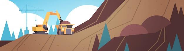 Excavatrice lourde chargeant du sol sur un équipement professionnel de camion benne