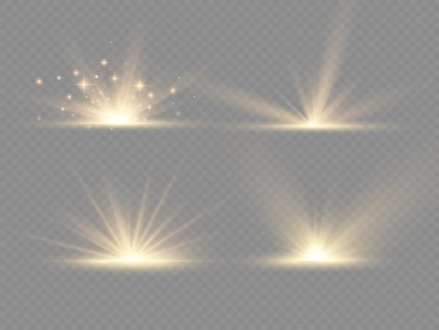 Explosion d'étoiles sur fond transparent, rayons de soleil lumières lueur jaune, effet spécial flare avec des rayons de lumière.