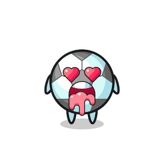 L'expression amoureuse d'un ballon de football mignon avec des yeux en forme de coeur, un design de style mignon pour un t-shirt, un autocollant, un élément de logo