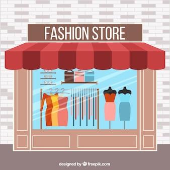 Façade du magasin de mode en design plat avec des mannequins