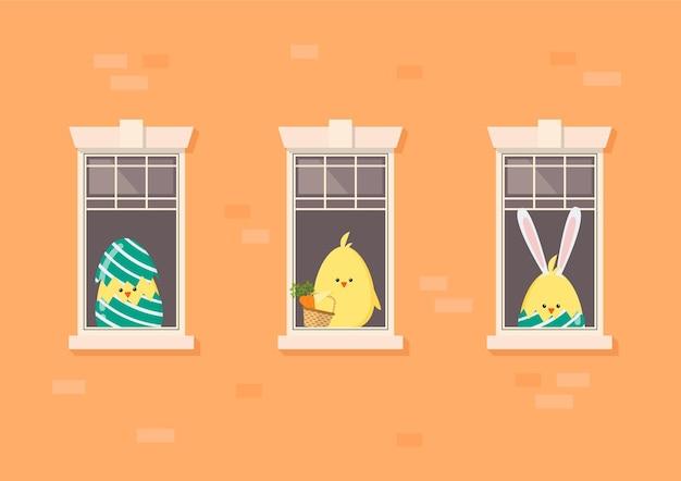 Façade de l'immeuble d'appartements avec poulets de pâques voisins