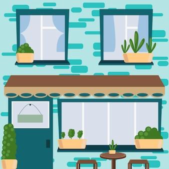 Façade d'un immeuble résidentiel avec un café au rez-de-chaussée et des fenêtres au deuxième