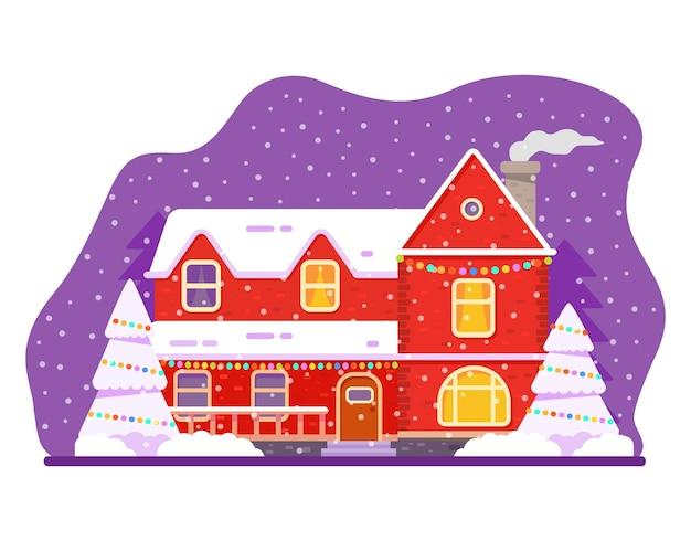 Façade de la maison de noël décorée guirlande dans les chutes de neige.