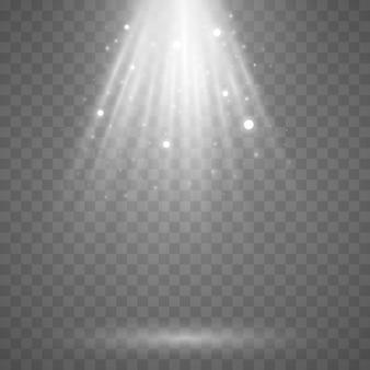 Des faisceaux de lumière avec de la poussière volante et des particules incandescentes