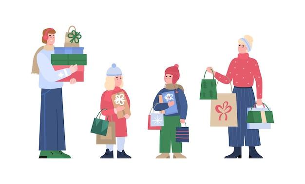 Une famille d'acheteurs heureux avec des enfants tient des sacs et des colis avec des cadeaux de noël
