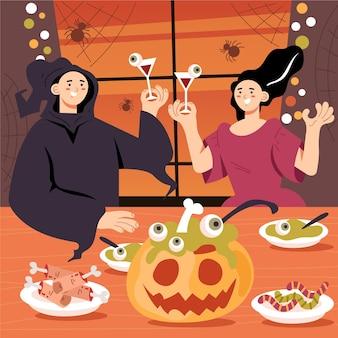 Famille appréciant un dîner d'halloween