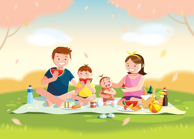 Famille appréciant le pique-nique.
